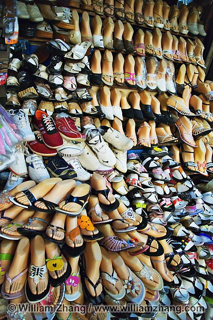 Display of shoes on manikin feet at market. Siem Reap