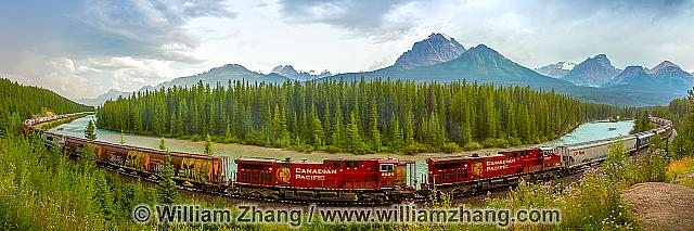 Panorama of endless freight train at Morant's Curve. Banff, Albe