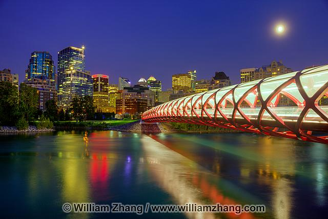 Reflections of Peace Bridge and downtown in Bow River. Calgary