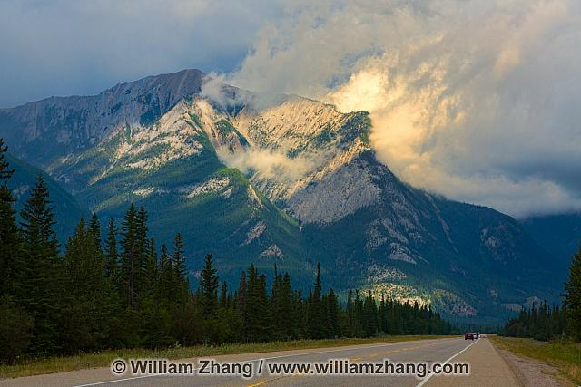 Sunshine through the clouds on mountain peaks. Jasper NP
