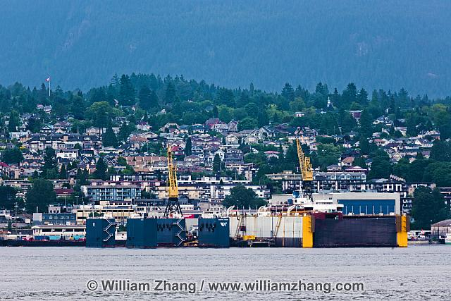 North Vancouver houses and drydock along shore. BC, Canada