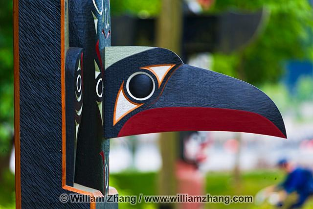 Carved raven on totem in Stanley Park. British Columbia, Canada