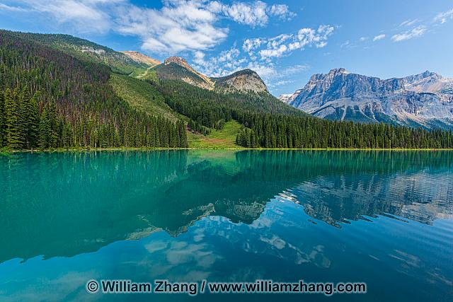 Emerald Lake ringed by mountains reflected in waters at Yoho NP