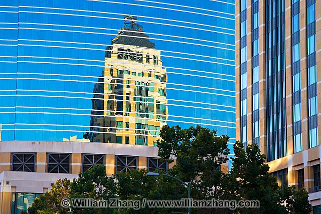 Blue glass reflection of downtown office building. Oakland, CA