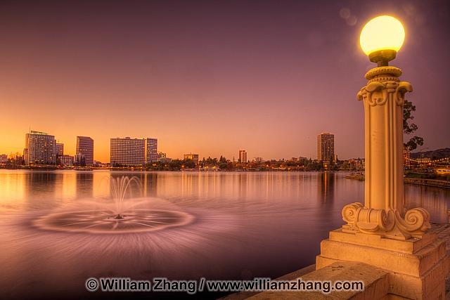 Lampposts and fountain at twilight at Lake Merritt. Oakland, CA