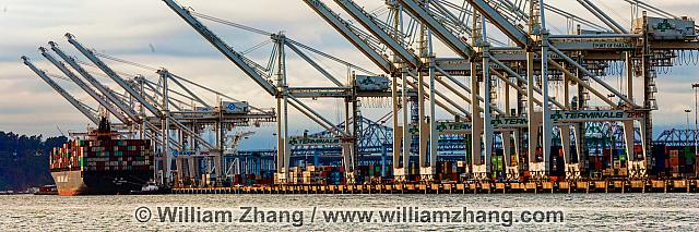 Panorama of port with cranes and container ships. Oakland, CA