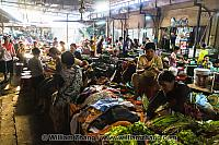 Piles of vegetables and clothes at market. Siem Reap