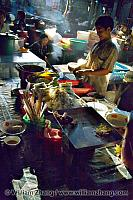 Cook and ingredients at market. Siem Reap
