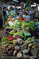 Long counter of vegetables for sale at market. Siem Reap