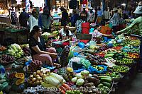 Vegetables sold by seated women at market. Siem Reap