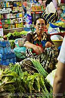Woman selling green onions and lettuce at market. Siem Reap