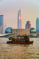 Huangpu River tour boat and Jinmao Tower. Shanghai