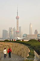 Walking past monument with Pudong in distance. Shanghai