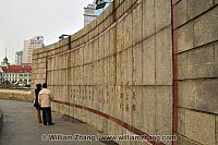 Viewing monument inscriptions on wall. Shanghai