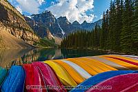 Canoes on Moraine Lake dock and Wenkchemna Peaks. Banff, Alberta