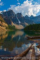 Logs in Moraine Lake and nearby Wenkchemna Peaks. Banff, Alberta