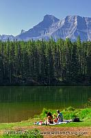 Johnson Lake calm for a picnic in Banff. Alberta, Canada