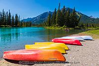 Boats along shore of Bow River in Banff. Alberta, Canada