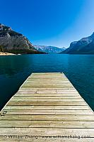 Dock ends in Lake Minnewanka in Banff. Alberta, Canada