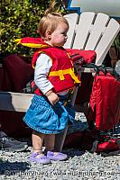 Child wearing a life vest near the Bow River. Banff, Alberta