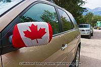 Canadian flag covers vehicle mirror in Alberta. Canada