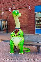 Green dinosaur on bench in Drumheller