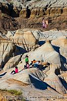 Children climb on hoodoos near Drumheller. Alberta
