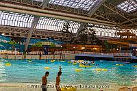 Swimmers in inner tubes at water park at West Edmonton Mall