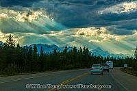 Rays of sunshine burst through clouds along Icefields Parkway
