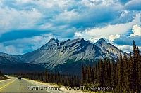 Rocky Mountains rise high above Icefields Parkway. Alberta