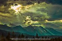 Mountains, clouds and rays of sunshine along Icefields Parkway