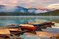 Boats on dock at Patricia Lake at sunrise. Jasper National Park