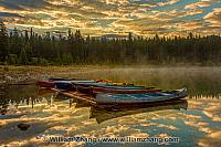 Patricia Lake with morning clouds and sunrise reflection. Jasper