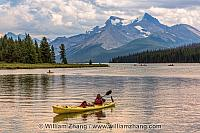 Yellow kayak on Maligne Lake in Jasper National Park. Alberta