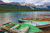 Maligne Lake and painted boats in Jasper National Park. Alberta