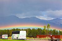 Low rainbow over Athabasca River in Jasper townsite. Alberta