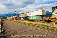 Double stacked freight train moves through Jasper train station