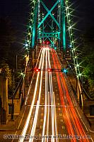 Traffic on Lion's Gate Bridge at night in Vancouver. BC, Canada