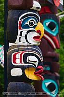 Two carved and painted totems in Stanley Park. BC, Canada
