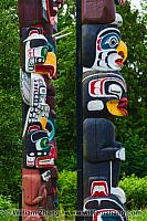 Two totems in profile in Stanley Park. British Columbia, Canada