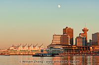 Moon above Vancouver city centre buildings. BC, Canada
