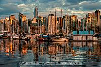 Reflections from boats and buildings in Vancouver. BC, Canada