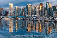 Reflections of Vancouver buildings and boats. BC, Canada