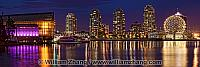 Night panorama of False Creek buildings in Vancouver. BC, Canada