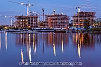 Reflection on False Creek of construction cranes in Vancouver. B