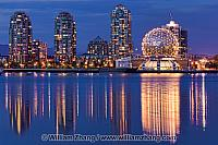 Reflections in False Creek of dome and buildings in Vancouver, B