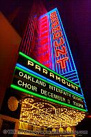 Neon sign and marquee at Paramount Theatre at night. Oakland, CA