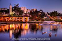 Pergola lights reflect on Lake Merritt near fountain. Oakland, C