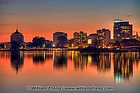 Sunset reflections of buildings at Lake Merritt. Oakland, CA