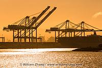 Silhouetted cranes at twilight at port. Oakland, CA